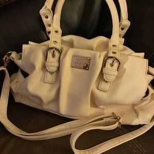 Cecil Mcbee 2-way bag. Has long strap up 24 inches